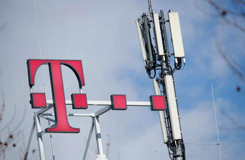 Logo of German telecommunications giant Deutsche Telekom AG and GSM antennas are seen atop of the headquarters of Deutsche Telekom in Bonn