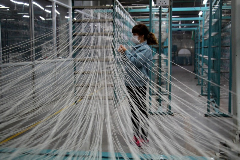 Woman works at a workshop of a textile manufacturer in Binzhou, Shandong