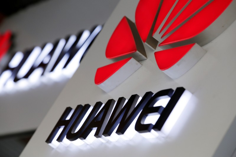 FILE PHOTO: Logos of Huawei are pictured outside its shop in Beijing