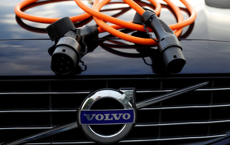 FILE PHOTO: An electric vehicle charging cable is seen on the bonnet of a Volvo hybrid car in this picture illustration