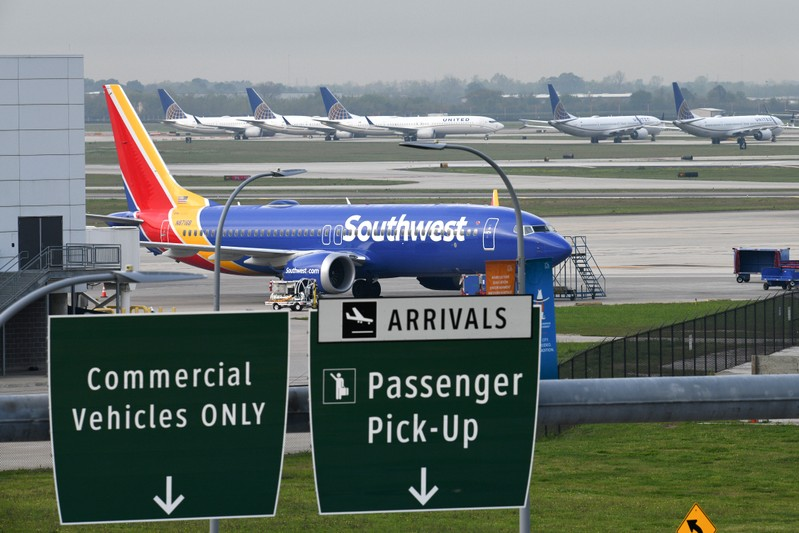 FILE PHOTO: A Southwest Airlines Boeing 737 MAX 8 aircraft is pictured in front of United Airlines planes, including Boeing 737 MAX 9 models, at William P. Hobby Airport in Houston