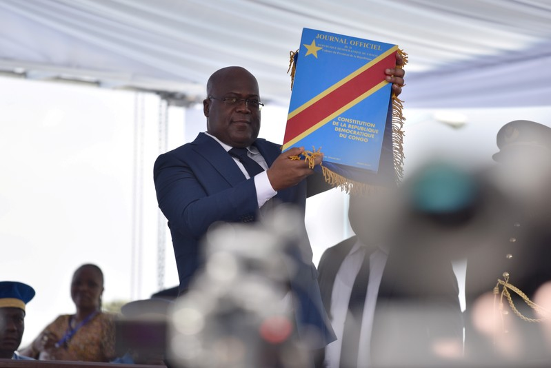 FILE PHOTO: Felix Tshisekedi holds up the constitution during his presidential the inauguration ceremony in Kinshasa, Democratic Republic of Congo