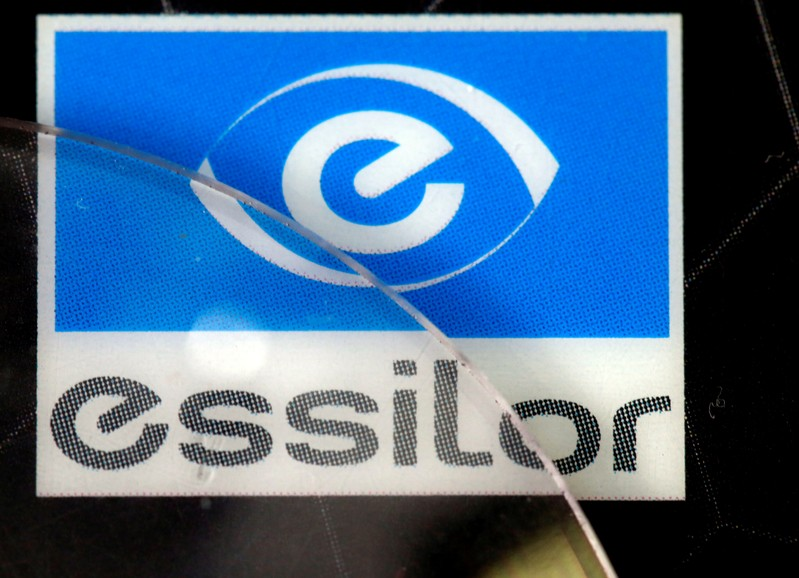 FILE PHOTO: Lens producers Essilor' s logo is seen in an optician shop in Paris