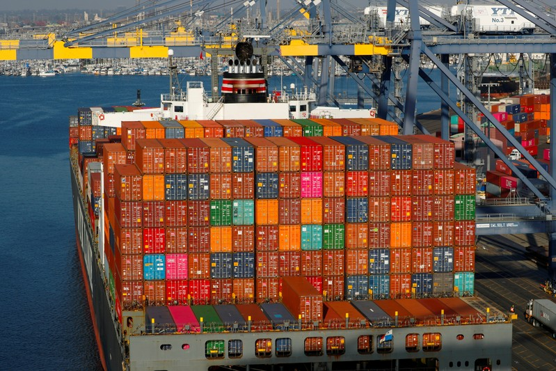 FILE PHOTO: Shipping containers are pictured stacked on a ship docked at Yusen Terminals at the Port of Los Angeles
