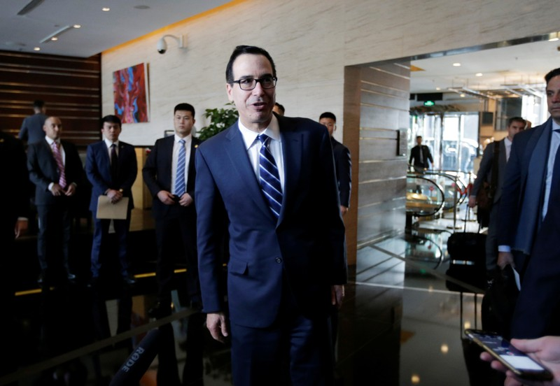 FILE PHOTO: U.S. Treasury Secretary Steven Mnuchin, a member of the U.S. trade delegation, speaks to the media upon his arrival at a hotel in Beijing
