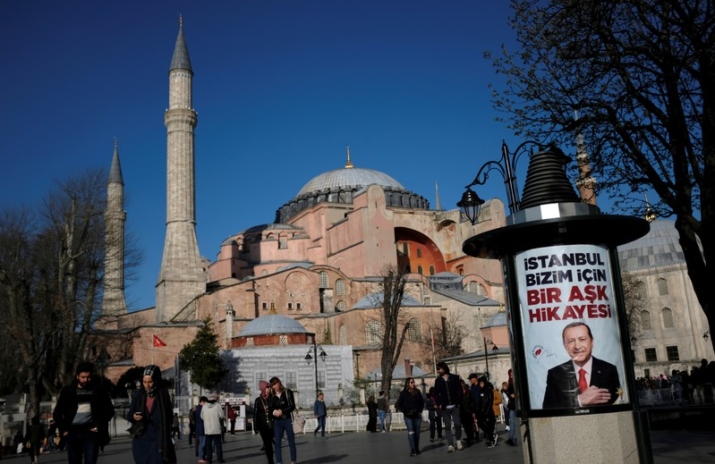 An election banner of Turkish President Tayyip Erdogan, with the Byzantine-era monument of Hagia Sophia in the background, is pictured in Istanbul