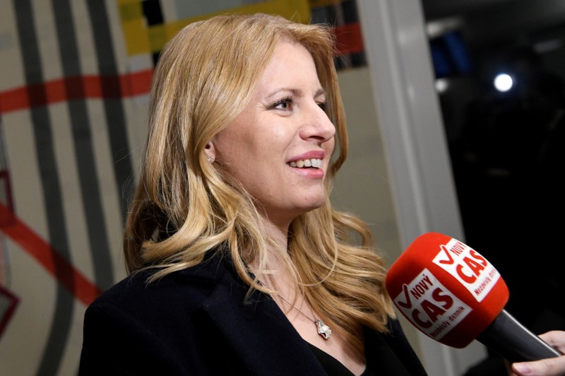 FILE PHOTO: Slovakia's presidential candidate Zuzana Caputova speaks with journalists after a televised debate with her opponent Maros Sefcovic (not pictured) ahead of an election run-off, at TV Markiza