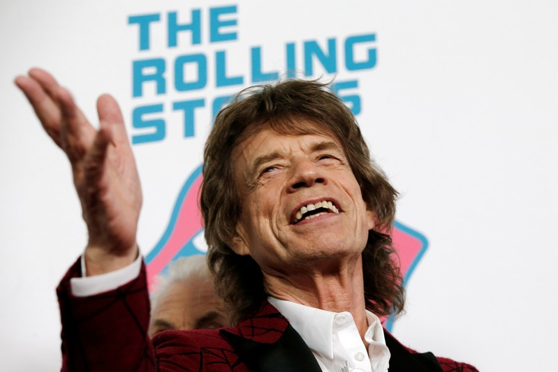 FILE PHOTO: Mick Jagger of The Rolling Stones poses for photographers as the band arrives for the opening of the new exhibit