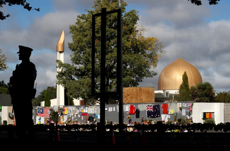 FILE PHOTO: A police officer stands guard outside Al Noor mosque in Christchurch