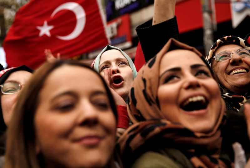 Supporters of Turkish President Erdogan cheer during a rally for the upcoming local elections in Istanbul