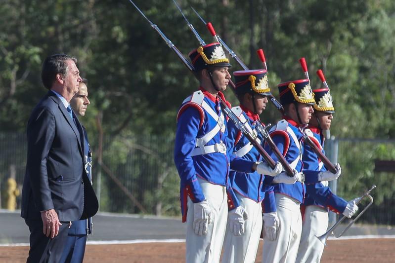 Brazil's President Jair Bolsonaro attends a flag hoisting ceremony at Alvorada Palace in Brasilia