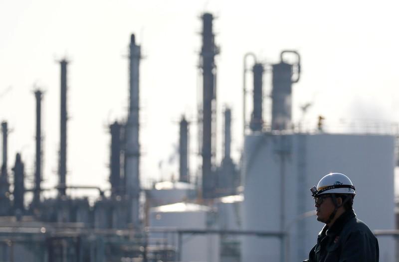 FILE PHOTO: A worker walks near a factory at the Keihin industrial zone in Kawasaki