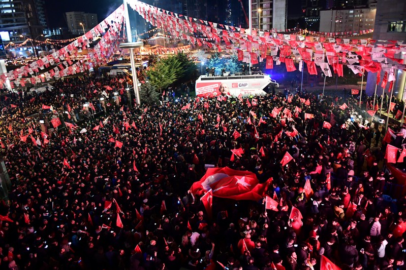 Supporters of the main opposition CHP gather in front of the party's headquarters to celebrate the municipal elections results in Ankara