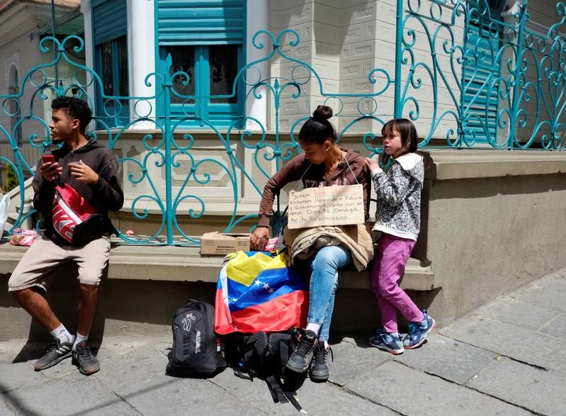 Venezuelan migrants are seen in the centre of La Paz