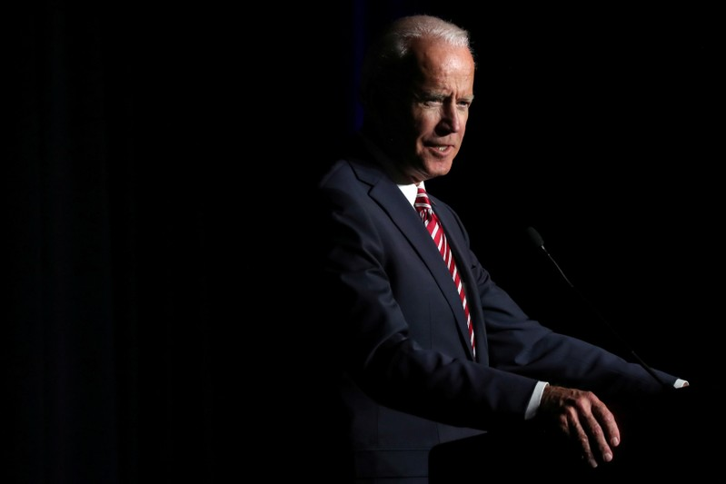 FILE PHOTO: U.S. former Vice President Biden delivers remarks at the First State Democratic Dinner in Dover, Delaware