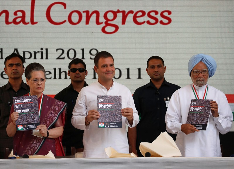 Rahul Gandhi, President of India's main opposition Congress party, his mother and leader of the party Sonia Gandhi and India's former Prime Minister Manmohan Singh display copies of their party's election manifesto for the April/May general electio