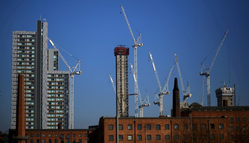 FILE PHOTO: Construction cranes are seen above a refurbished Mill building in the city centre of Manchester