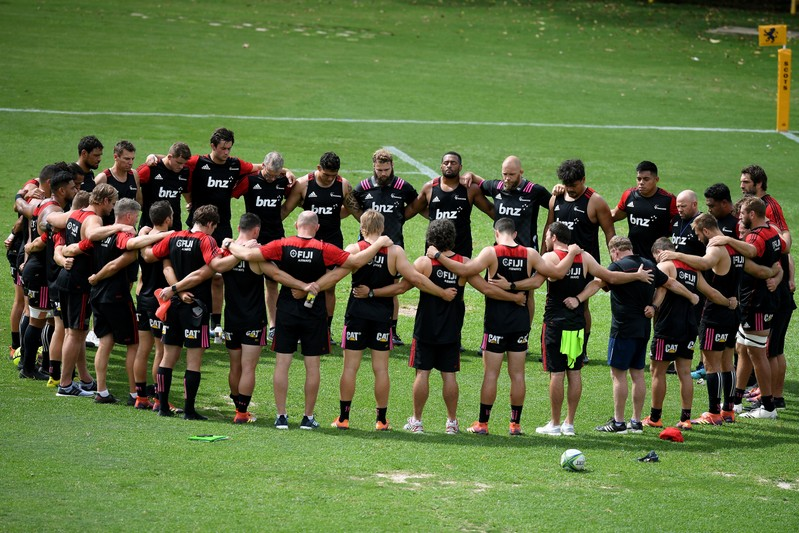 Canterbury Crusaders players and staff pause during their Captain's Run training session for two minute's silence, a week on from the Christchurch attack, at 11.32am Sydney time, at The Scots College, in Sydney
