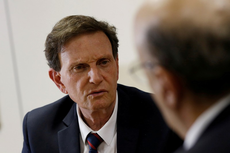 FILE PHOTO: Rio de Janeiro's Mayor Crivella speaks with Brazil's Finance Minister Meirelles during a meeting in Brasilia