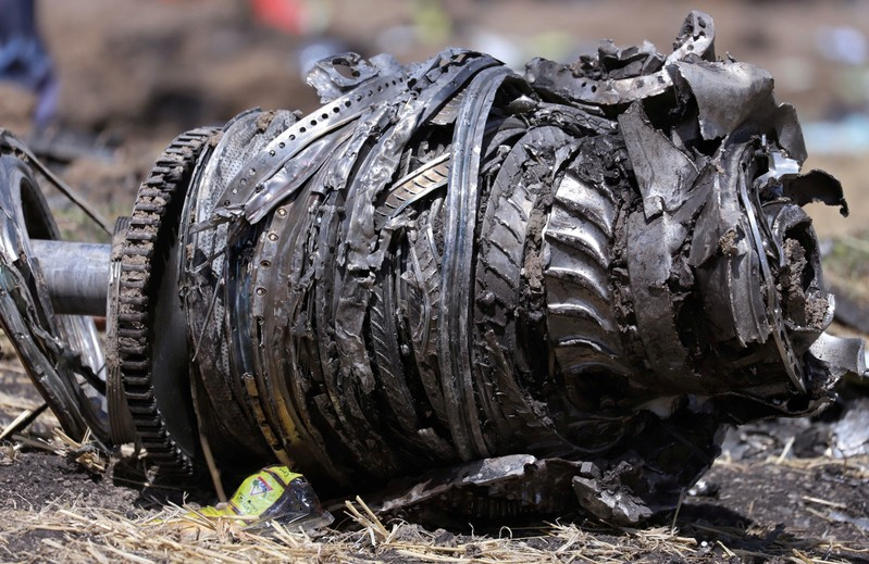 FILE PHOTO: Airplane engine parts are seen at the scene of the Ethiopian Airlines Flight ET 302 plane crash, near the town of Bishoftu