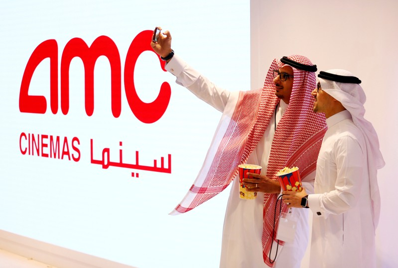 FILE PHOTO: Two Saudi men take a selfie at Saudi Arabia's first commercial movie theater in Riyadh