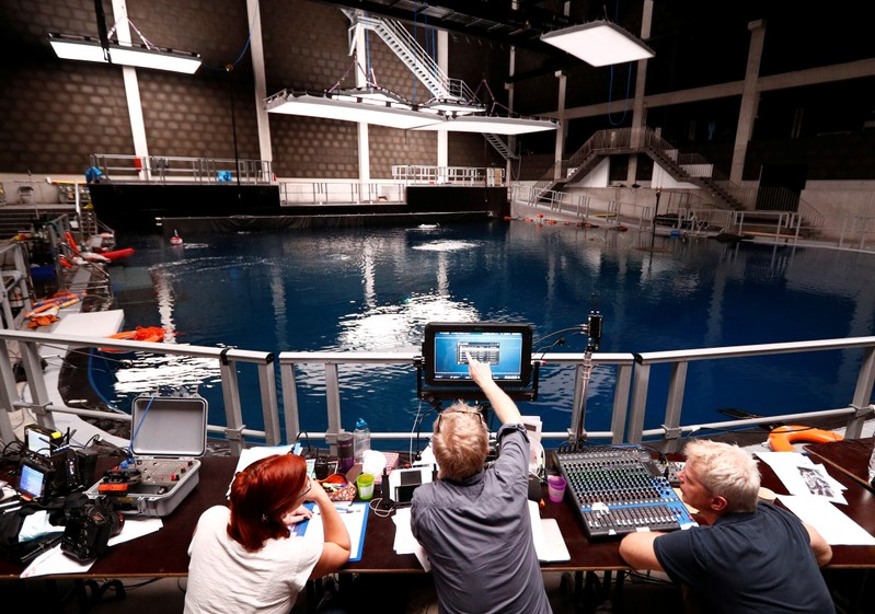 Director and technicians work in the underwater cinema studio