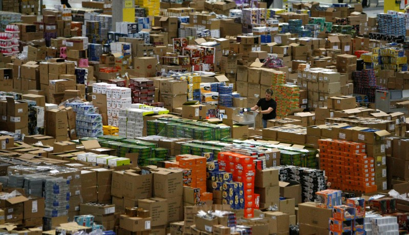 FILE PHOTO: A worker sorts packages at the Amazon warehouse in Leipzig