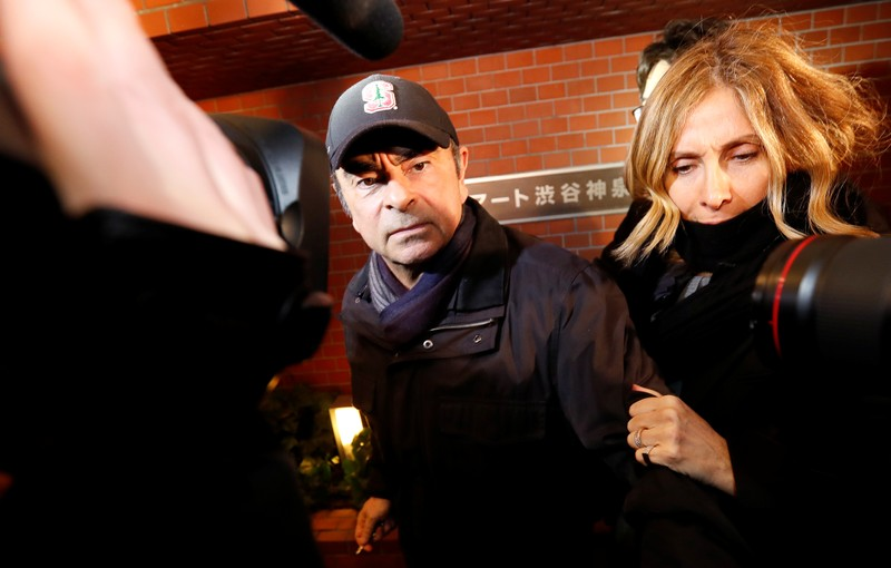 Former Nissan Motor Chairman Carlos Ghosn accompanied by his wife Carole Ghosn arrives at his place of residence in Tokyo