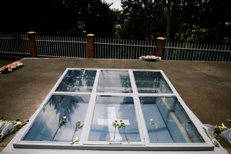 Flowers are seen on a grave site for victims of the Rwandan genocide at the Genocide Memorial in Gisozi in Kigali