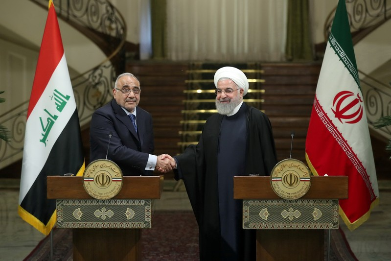 FILE PHOTO: Iranian President Hassan Rouhani shake hands with Iraq's Prime Minister Adel Abdul Mahdi during a news conference in Tehran
