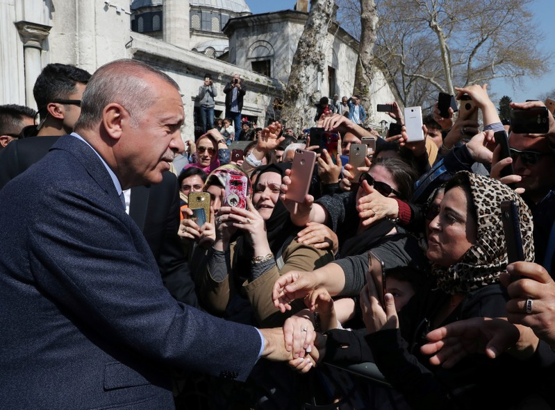 FILE PHOTO: Turkish President Erdogan is greeted by his supporters as he leaves a mosque after the Friday prayers in Istanbul