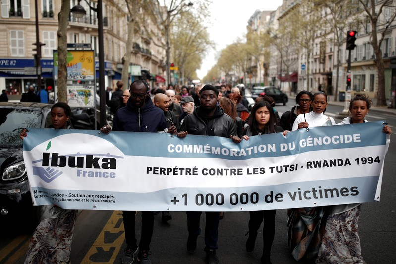 People take part in a silent walk to commemorate the 25th anniversary of the Rwandan genocide in Paris