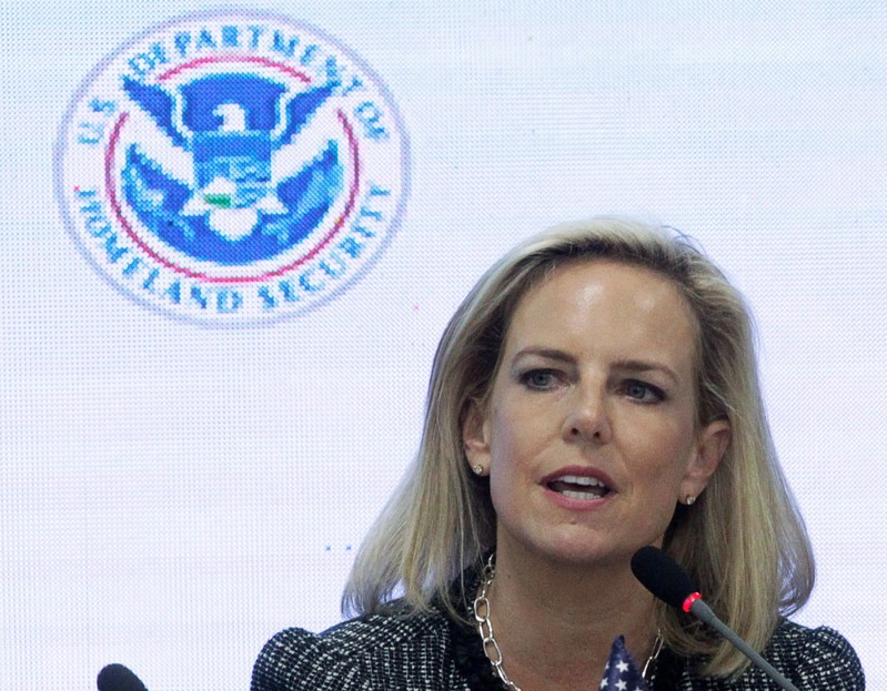 FILE PHOTO: U.S. Secretary of Homeland Security Kirstjen Nielsen speaks beside Honduras' President Juan Orlando Hernandez during a multilateral meeting at the Honduran Ministry of Security in Tegucigalpa,