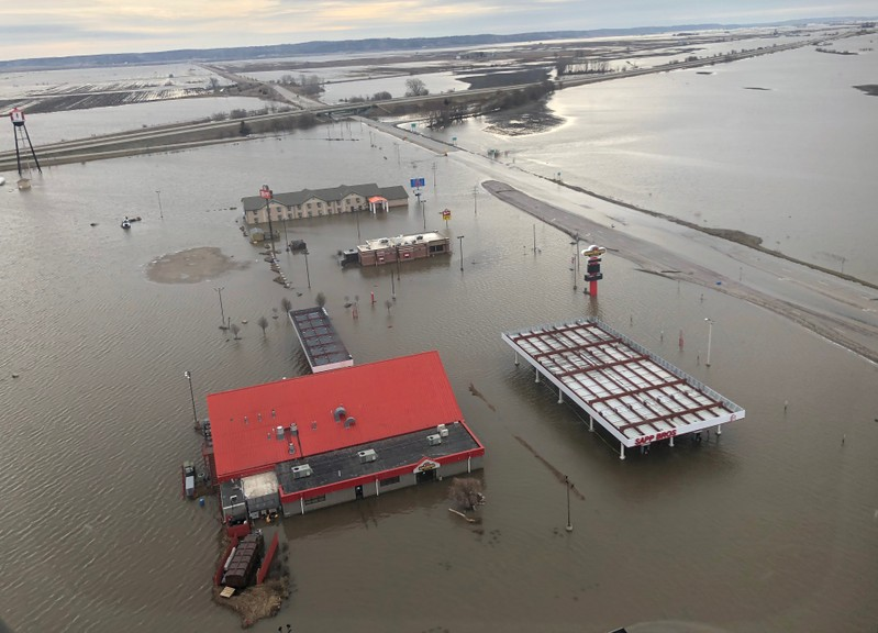 FILE PHOTO: A motel, restaurant and travel stop are shown surrounded by flood waters in this aerial photo in Percival, Iowa