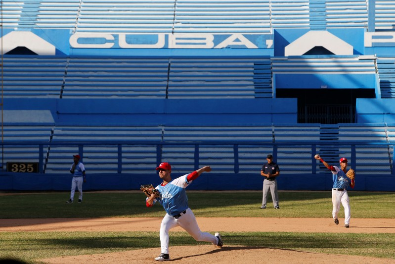 Cuba's national youth baseball pitcher Oscar Hernandez warms up before a friendly game against Japan at the Latinoamericano stadium in Havana