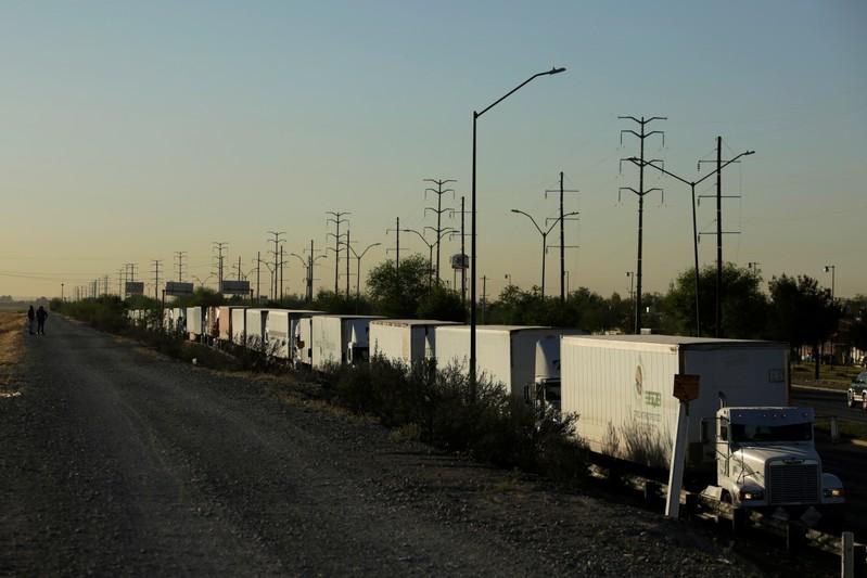 Trucks wait in queue for border customs control to cross into the U.S. at the Cordova-Americas border crossing bridge in Ciudad Juarez