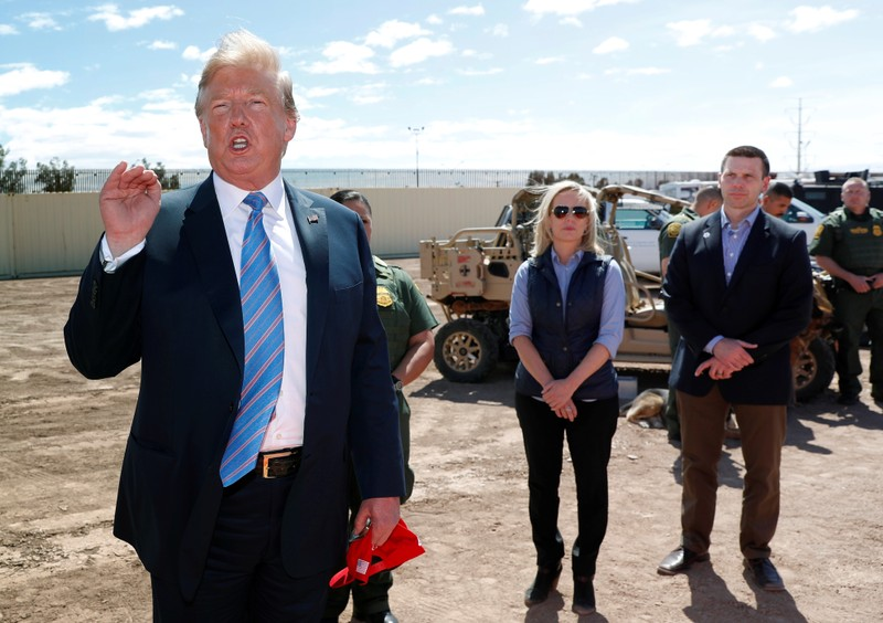 FILE PHOTO: Neilsen and McAleenan listen to Trump at border security tour in California