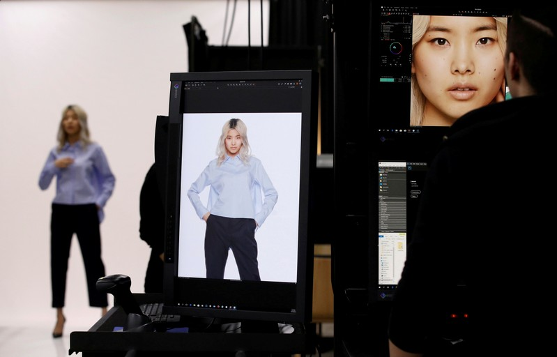 FILE PHOTO: A model is seen during a shooting session for Amazon Fashion at an unveiling of its new photo studio in Tokyo