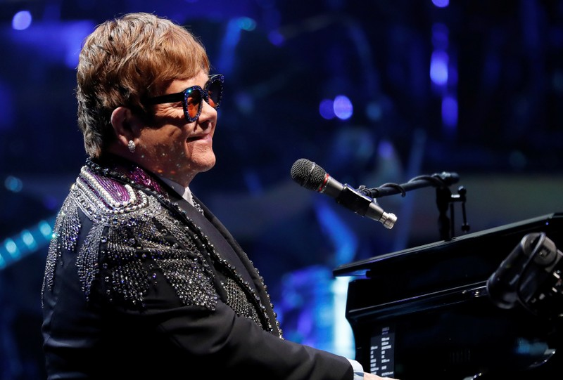 Elton John performs during his