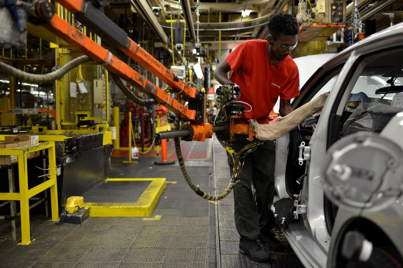 FILE PHOTO: A line worker installs the front seats on the flex line at Nissan Motor Co's automobile manufacturing plant in Smyrna Tennessee