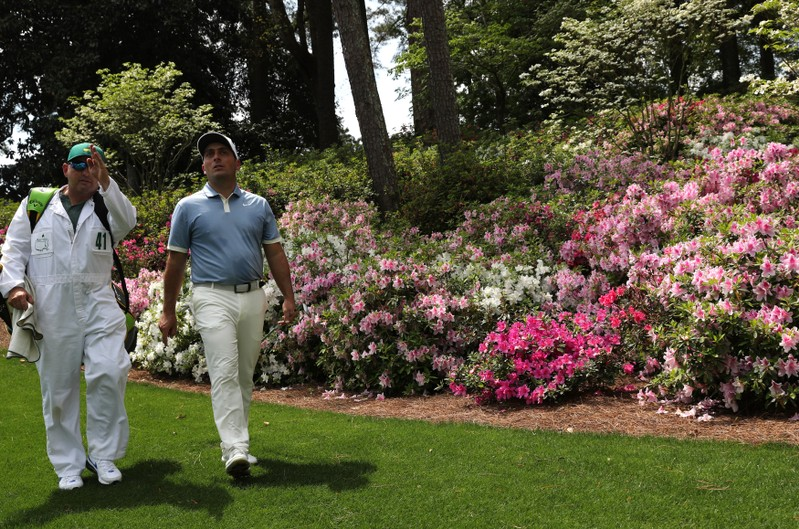 Francesco Molinari of Italy walks down the 6th fairway during practice for the 2019 Masters golf tournament at the Augusta National Golf Club in Augusta, Georgia, U.S.