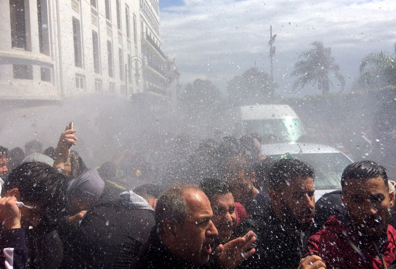Police officers use water cannon to disperse people protesting after parliament appointed upper house chairman Abdelkader Bensalah as interim president in Algiers