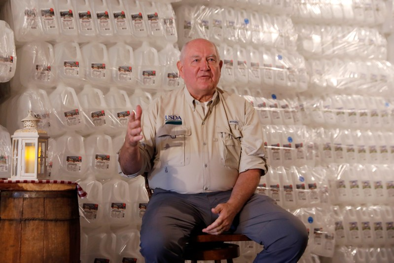 FILE PHOTO: U.S. Agriculture Secretary Sonny Perdue speaks to dairy farmers at Trinity Valley Dairy in Cortland