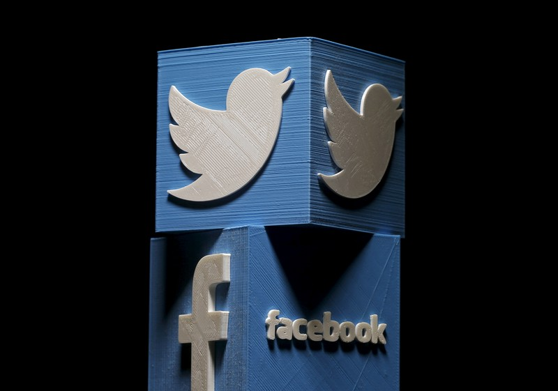 3D-printed Facebook and Twitter logos are seen in this picture illustration made in Zenica