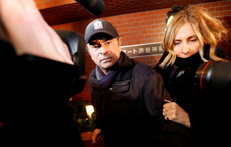 FILE PHOTO: Former Nissan Motor Chairman Carlos Ghosn accompanied by his wife Carole Ghosn, arrives at his place of residence in Tokyo