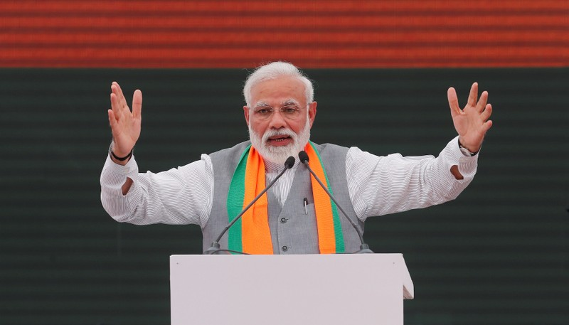 FILE PHOTO: Indian Prime Minister Narendra Modi gestures as he speaks after releasing BJP's election manifesto for the April/May general election, in New Delhi