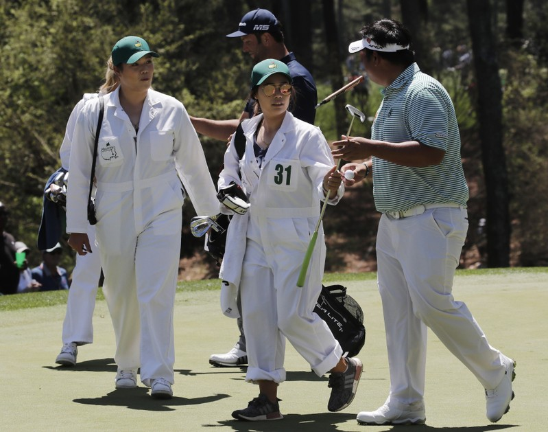 Sisters caddie for Kiradech Aphibarnrat of Thailand during the 2019 Masters golf tournament's par 3 contest at the Augusta National Golf Club in Augusta, Georgia, U.S.