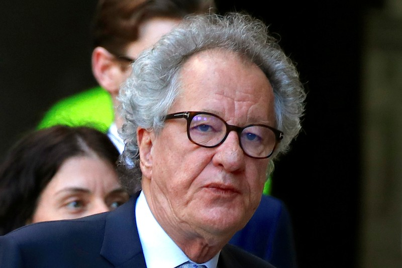 Australian actor Geoffrey Rush reacts as he arrives at the Federal Court in Sydney