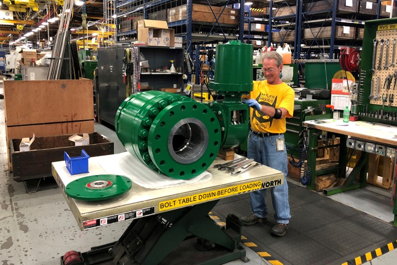 FILE PHOTO: A worker assembles an industrial valve at Emerson Electric Co.'s factory in Marshalltown Iowa