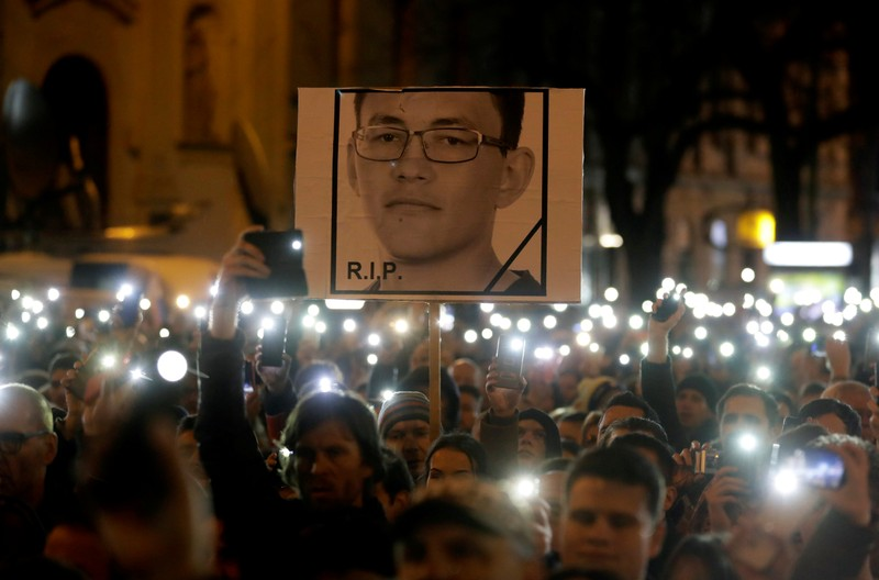 FILE PHOTO: Demonstrators take part in a protest rally marking the first anniversary of the murder of investigative reporter Jan Kuciak and his fiancee Martina Kusnirova in Bratislava